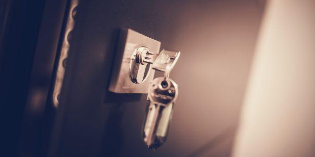 Office Metal Door Lock and Keys Closeup Photo.